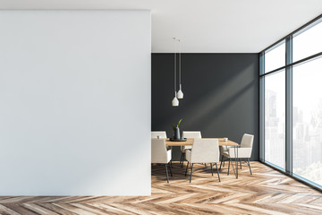Gray and white dining room with mock up wall