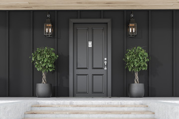 Black front door of black house with trees Wall mural