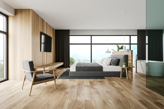 Wooden master bedroom and bathroom interior