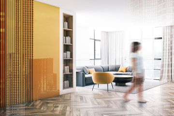 Woman walking in white and yellow living room