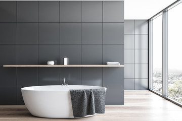 Panoramic gray tile bathroom interior with tub
