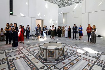 Media gather for the unveiling of an exhibit featuring a natural pearl, that archeologists claim to be 8000-years-old, at the Louvre Abu Dhabi Museum in Abu Dhabi