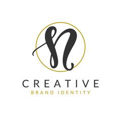 Letter N Logo Design Template. Vector Brush Hand Written Calligraphy Sign Icon