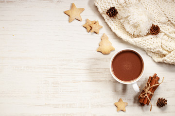 Papiers peints Chocolat Hot chocolate in white cup with star shaped cookies