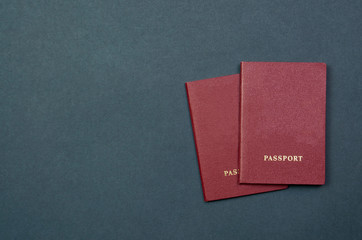 Two passports with on a black background for customs top view. place for text