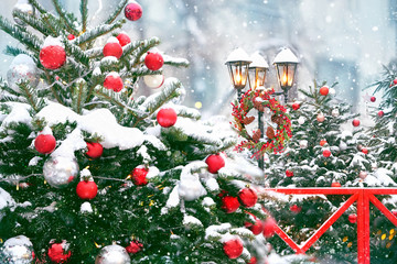 Christmas lantern. Merry Christmas and happy new year concept. Christmas tree, winter lantern and Christmas wreath. beautiful holiday winter decor, snowy landscape. copy space