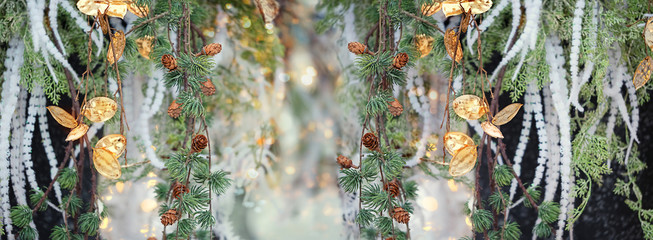 beautiful floral background. chic golden flowers and fir tree branch. elegant festive decoration, Christmas and new year holiday background. soft selective focus