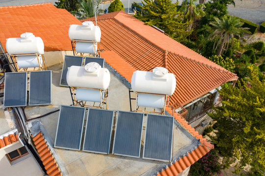 Solar panels. Solar thermal water heatihg system. Collectors are heated by the sun. Electricity is received from sunlight. Heated water from the sun. Green energy. Caring for the environment.