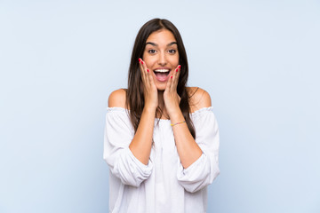 Young woman over isolated blue background with surprise facial expression