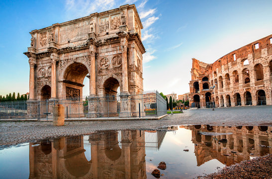 Arch of Constantine and Colosseum in Rome, Italy. Triumphal arch in Rome, Italy. North side, from the Colosseum. Colosseum is one of the main attractions of Rome. Rome architecture and landmark.