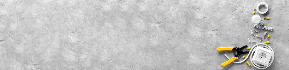 Electrician's supplies on grey background