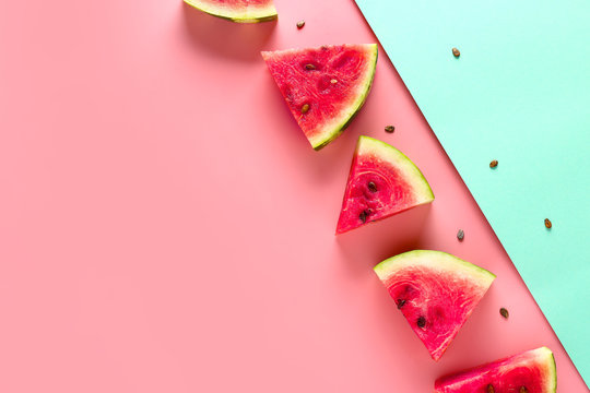 Slices of sweet ripe watermelon on color background