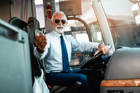 Mature beard bus driver sitting in bus..