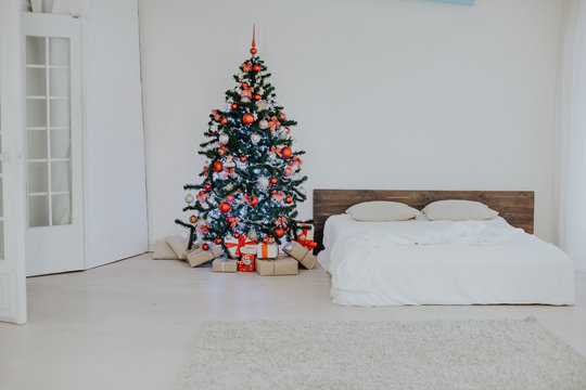 decor white bedroom with Christmas tree Christmas gifts