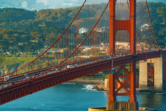 Traffic passes over San Francisco's Golden Gate Bridge from Marin County
