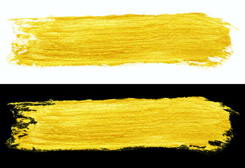 yellow gold colored doodle smear stroke isolated on black and white backgrounds, hand-drawn golden...