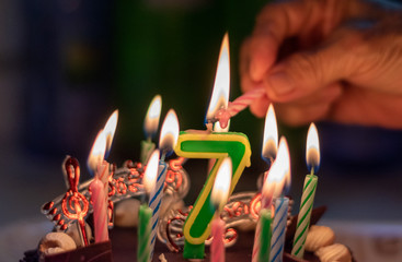 Happy Birthday cake with lighting candles for 7th years old or 7 anniversary
