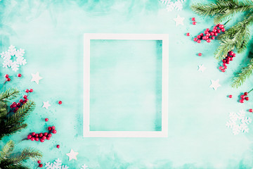 Watercolor painting Christmas holidays composition Top view of white picture frame with Christmas tree decoration and red berries on green pastel background with copy space for text.
