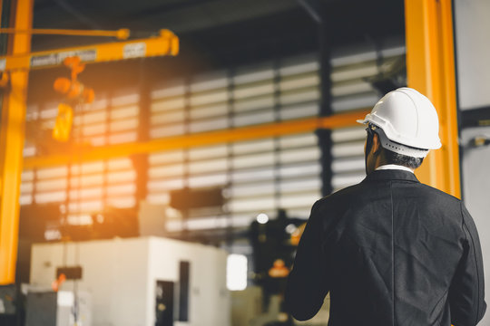 industrial Engineer or Manufacturer wearing white hard safety helmet hat from safety project look workplace high Quality Plastic Mold or Industry Manufacturing Factory, Various Metalworking Processes.