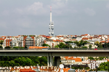 View of the roofs and houses in Visegrad and Zizkov TV tower in Prague.