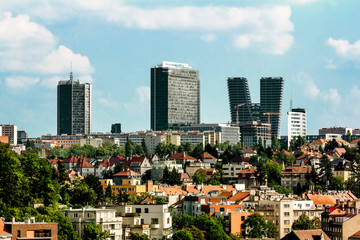 View of the old building on the background of high-rise buildings in Prague.