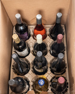 Delivery of case of wines from Naked Winery in cardboard box