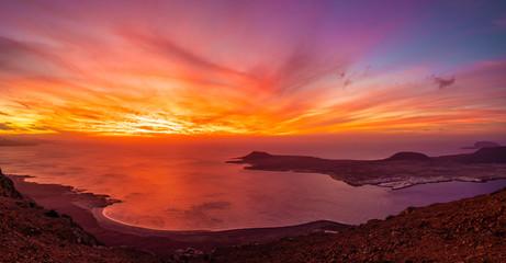 Wall Mural - View at Atlantic ocean and La Graciosa islands at sunset, Lanzarote, Canary Islands, Spain