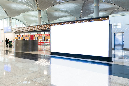 Blank advertising billboard in the Airport, blank billboards public commercial with plane passengers.