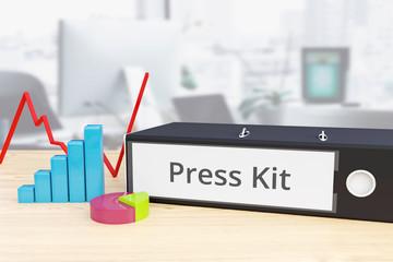 Press Kit – Finance/Economy. Folder on desk with label beside diagrams. Business/statistics. 3d rendering