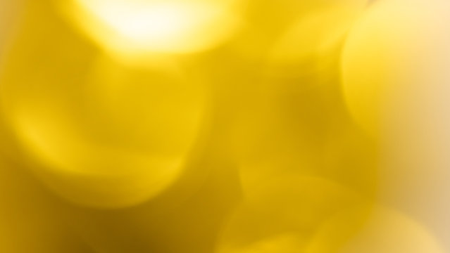 Abstract beautiful light bokeh golden and yellow circle background