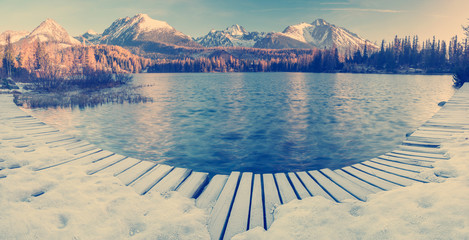 Wall Mural - mountain lake Strbske Pleso in Slovakia, lake in winter scenery-vintage, retro toning