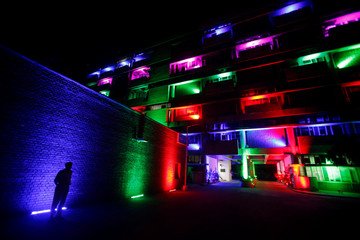A policeman stands in front of the secretariat building illuminated by colourful lights during Diwali celebrations in Chandigarh