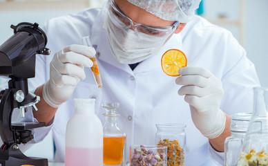 Fototapeta Chemist mixing perfumes in the lab