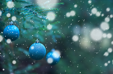 blue Christmas balls on Christmas tree branches background