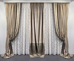 Straight velvet curtains and translucent tulle with embroideryin classic style