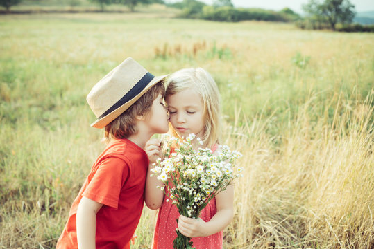 Love. Valentines day. Festive Art Greeting Card. Childhood on countryside. Lovely children. Human emotions - kids first love. Cute little children enjoying at countryside.