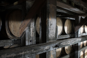 Fototapete - Bourbon Warehouse with barrels tightly crammed