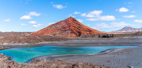 Wall Mural - Landscape with red volcano near Los Hervideros caves in Lanzarote, Canary Islands, Spain