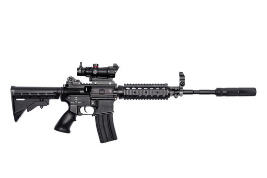 Airsoft rifle with silencer and collimator isolated on the white background. Top view.