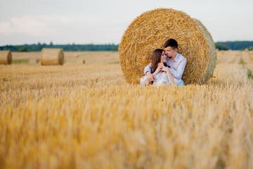 Happy young couple on straw, romantic people concept, beautiful landscape, summer season Fotoväggar