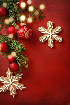 christmas ornaments on red background, border with copy space