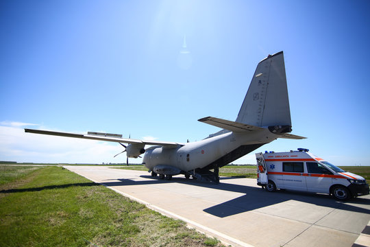 An ambulance is parked near the rear exit of an Alenia C-27J Spartan military cargo plane from the Bulgarian Air Force that landed on a military airbase during a drill.