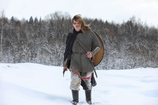 Defender the young warrior in mail armor