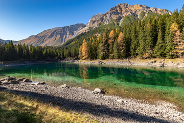 Wall Mural - Autumn time at romantic forest Lake Obernberg one of the best known mountain lakes in Austria, Tyrol.