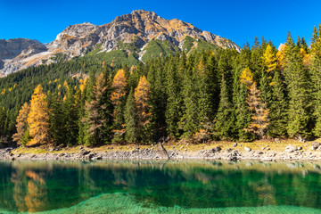 Wall Mural - Autumn colours at mountain lake in the Alps, Austria,Tyrol, Lake Obernberg, Stubai Alps.