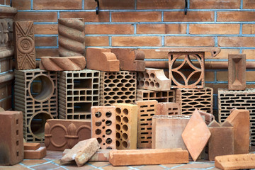 Red clay bricks and blocks for building and construction, close-up