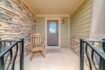 Front porch of modern house with rocking chair