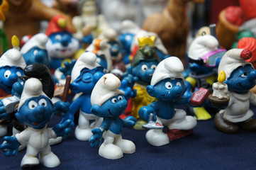 KUALA LUMPUR, MALAYSIA -DECEMBER 9, 2018:  Selective focused of fictional cartoon action figure Smurfs in miniature model displayed for the public on a desk.