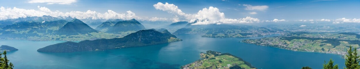 Switzerland, Panoramic view on green Alps in clouds and lake Lucerne