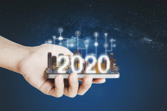 Smart technology on mobile device, Hand holding mobile smartphone and 2020 augmented reality, new technology development